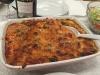 Italiensk kylling-pølseret med oliven og parmasan